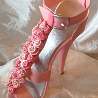 Pink High Heel W/ruffled Flowers..   This high heel will be going on a simple 6 inch butter cake. Happy Mother's Day!