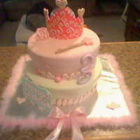 Bella's 3! This is a choc/choc and a french vanilla/vanilla flavored cake, covered in MMF, Gumpaste crown painted, dragees held in place by royal...