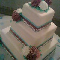 Sophisticated Fall   Sophisticated fall wedding, ivory fondant, teal and burgundy stripes, grey and white piping, edible icing mums