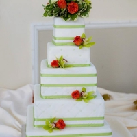 "Elegant Green And Orange 12"" & 10"" fake tiers, 8"" & 4"" banana tiers, 6"" cookies & cream tier all with buttercream filling &amp..."