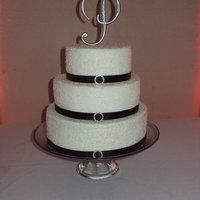 "Simple Crystals 10"" marble cake w/buttercream filling & frosting. 8"" & 6"" fake tiers w/buttercream frosting. Clear sparkle sugar &..."