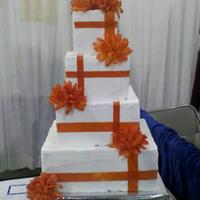 "Orange Contemporary 4-tier display cake made for an expo. All fake tiers, 10"", 8"", 6"", 4"" with buttercream frosting & silk ribbon/..."