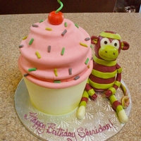 Giant Cupcake With Sock Monkey I just finished this cake for a friend's 30th Birthday. The cupcake is the WASC recipe made with chocolate cake for the bottom, and...