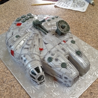 Millenium Falcon My first fondant shaped cake for a customer! It's yellow cake with vanilla buttercream, covered in fondant and details with royal...