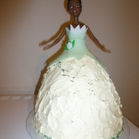 Princess Tiana Another doll cake. White cake with raspberry filling. Buttercream icing with fondant accents