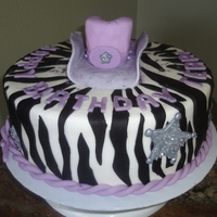 Zebra/cowgirl Cake I had a request to make a cake with zebra stripes and cowgirl accents in a purple color and sparkly. This is the result.