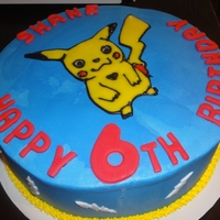 Pikachu Cake My first attempt at a poured sugar technique. Cake is buttercream with fondant accents and the poured sugar on the Pikachu character.