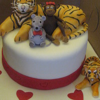 Tiger-Lover Birthday Cake Client requested a birthday cake for a woman who loves Tigers. He also wanted some animals with the tiger to represent her 3 children: a...