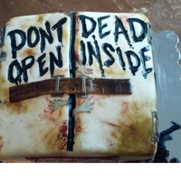 Zombie Themed Birthday Cake Mmmarrggll Aarrrrpphgggl . . . . I mean Oreo buttercream!!! 4 layers of chocolate death filled with oreo buttercream. The Zombie is a...