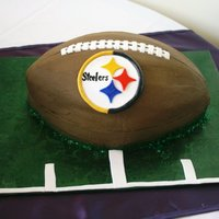 Steelers Football Grooms Cake Chocolate butter cream texturized with paper towel, accents in gumpaste