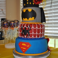 "Superheroes first 3 tiered cake....I still have so much to learn! 10, 8, and 6"", covered in fondant, and used candy clay mixed w/ gumpaste for the..."