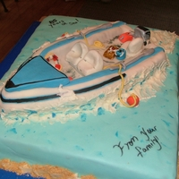 Speed Boat Cake carrot cake, buttercream icing, rice krispies, all hand made