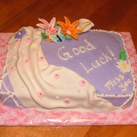 A Going Away Cake butter cream and fondant, hand made flowers