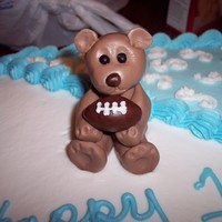 First Birthday Foot Ball this was for a first birthday, the request was baby blue and white, with a light brown teddy bear holding a football. this is my first...