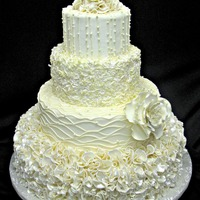 Ruffled Cake This cake is decorated in a mixture of fondant, icing, and white chocolate. the flower is made of gumpaste.