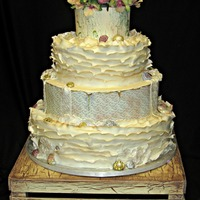 Shabby Chic   The top and third tiers have edible images. The 2nd and bottom tiers are fondant. The flowers are silk flowers.