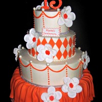 Orange And Silver Quinceanera Cake A cake for a 15th birthday, this cake was iced in BC, then fondant diamonds were added to the second tier and an orange fondant drape was...