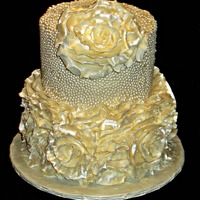 Ruffled Anniversary Cake  This cake was iced in BC then mini pearls were pressed into the icing on the top tier. Fondant ruffles were made into flowers, then fondant...