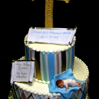 Robert's Baptism  This cake was designed for an infant boy's baptism. The cake was iced in BC with fondant accents. the baby and blanket were made of...