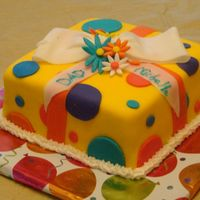 "Giftbox Cake This is my very first fondant and buttercream cake. It is a 8"" square white cake filled with strawberry filling and iced in MMF and..."