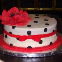 Black & White Anniversary Cake With Red Flower Red Velvet Cake with Cream Cheese Frosting and covered Cream Cheese Fondant. Fantasy Flower is made of Gumpaste and Embellishments are made...