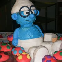 Brainy Smurf This cake was created for a friends little boy who just recently discovered The Smurfs! Chocolate cake covered in buttercream icing and MMF...