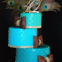 Feathered Fabulosity! Ombre Blue Tiered cake with feathers