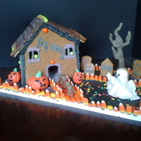Haunted Gingerbread House  I made this for a girl scout troop the girls did all the candy decorating. I added the pumpkins, ghost & tree. I think they did a great...