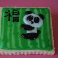 "Panda Cookie. Just trying out some ideas for my sister in law who is moving to China. The symbol means ""Good Luck"". I learned a lot after doing..."