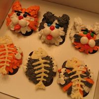 "Cat Cupcakes  Made these based on instructions in the book ""Hello, Cupcake"". Going to donate them to a charity bakesale for the benefit of..."