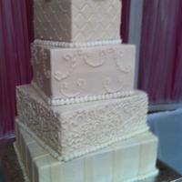 "Square Staggered Bride's Cake WASC squared staggered bride's cake iced with butter cream frosting. Fondant ribbon strips on bottom 12"" tier, coronelli heart..."