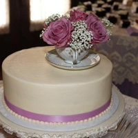 Elegant Tea Cup WASC iced with ivory butter cream, silk ribbon and butter cream pearl border. Real tea cup and roses.