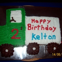 Truck Birthday Cake Chocolate cake iced with butter cream. Cake carved in the shape of a truck for childs birthday.