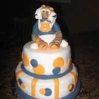 Aubie Baby Shower Cake  Made for parents who are HUGE Auburn Tiger fans. They didn't know the sex of their baby so Aubie was perfect. He even had on a diaper...