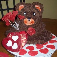 Valentinesday Cake  The teddy bear is a pound cake decorate with buttercream, the heart box is made from gumpaste and the other decorations are made with mmf....