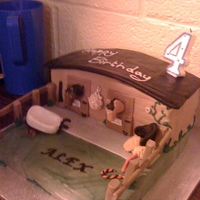 Stable Birthday Cake Stable yard birthday cake, made from chocolate cake, fondant & royal icing. Great fun to make!