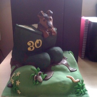 Wellington Boots With Dog & Flowers I made this cake for my best friends 30th she works with horses so spend her life in wellies!! the dog coming out of the wellies is an...