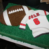Football Jersey Cake Half sheet cake with a wilton football pan on top. Fondant Jersey