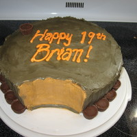 Giant Reese's Cup Done for friend's son's birthday who loves Reese's cups. Cake is white with buttercream icing and Reese's mini's...