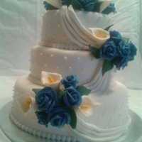 Wedding Cake 1/14/12  Chocolate cake, no filling and buttercream icing. Gumpaste roses, fondant calla lilies(i like it better then gum paste), fondant accents(...