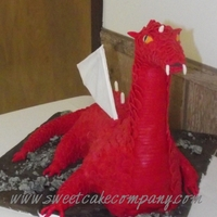 Red Dragon Cake Red Dragon Cake. Covered in fondant scales. Created this as a surprise grooms cake.