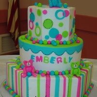 Bright Baby Shower Cake With Teddy Bears Buttercream frosted baby shower cake with fondant accents and fondant teddy bears.