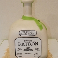 Silver Patron Bottle Cake Silver Patron Bottle Cake with hand-painted label and fondant lime.