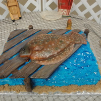 Floundering Around This was an 11x15 sheetcake with fondant wood planks and a RKT fish covered in fondant. This was a groom's cake for an avid fisherman...