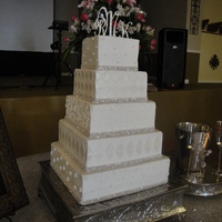 Kirsten 5-tier square cake with buttercream icing.