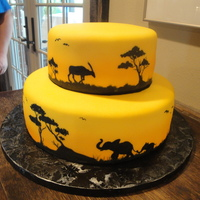 Safari Groom's Cake This was a 2-tier round cake, covered in yellow fondant and hand-painted with gel food coloring. It had all the animals on it that the...