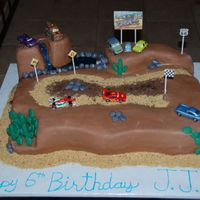 Cars 2 Race Track Cake This cake is for my son's 6th birthday. He wanted a cars (dirt) race track. Its chocolate cake with chocolate filling. He and all his...