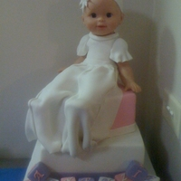 Christening Cake 2 Tier cake with doll dressed in fondant..