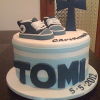 Converse Christening Cake Choc mint mud, everything is edible the shoes and cross are made of gumpaste whilst the rest is fondant