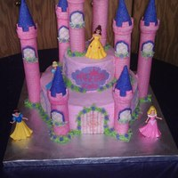 Princess Castle Cake The bottom layer is Vanilla cake with Vanilla Butter cream icing. The top layer is Chocolate and Vanilla Butter cream icing. The towers are...
